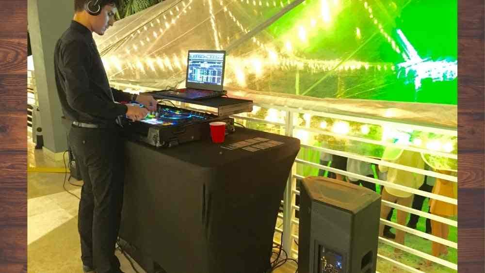 a DJ working on his laptop